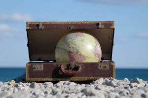 600-06553503 © Jean-Christophe Riou Model Release: No Property Release: No Globe in Suitcase on Rocky Beach, Frontignan, Herault, France